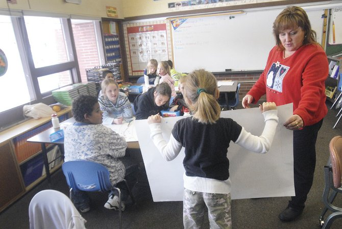 Wendy Seely's fourth-grade class works on Colorado history assignments Thursday afternoon at Sunset Elementary School. This week, the Colorado Department of Education released its school accountability report, which revealed that Moffat County students are scoring average on state assessments.