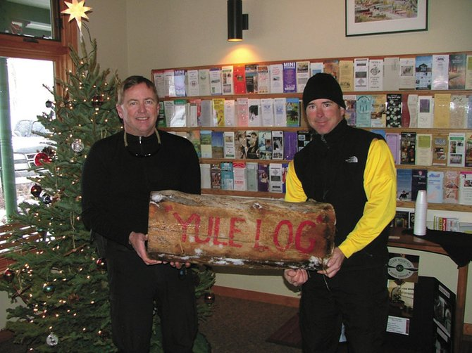 Steamboat Springs residents Tom Whiddon, left, and Scott Schaffer were first to find the Yule Log in 2006. This year's hunt begins Monday. Clues will be printed daily in the Steamboat Today.