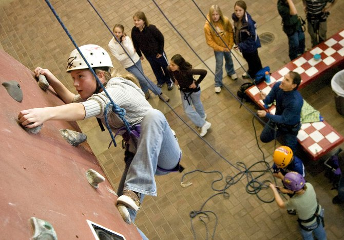 Steamboat Springs Middle School student Sara Stout scales the indoor climbing wall Wednesday.