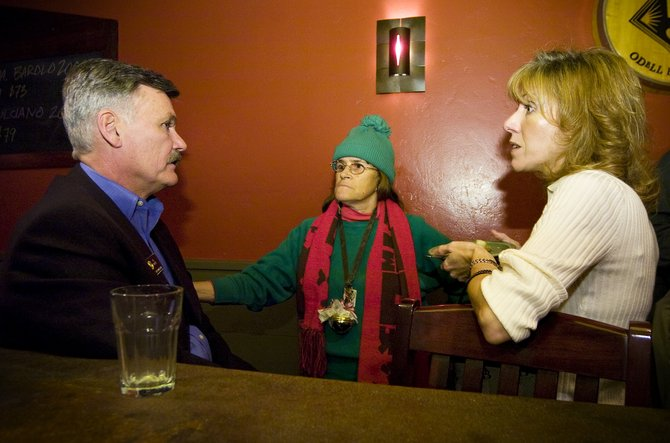 State Rep. Al White, R-Winter Park, left, visits with local residents Candace Noriega, center, and Julie Ann Carta during a reception at Mambo Italiano in Steamboat Springs on Saturday night.