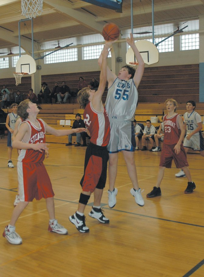 Craig Middle School center Adam Foster goes up for a shot against Steamboat Springs Middle School on Saturday. The Bulldogs capped off a 12-2 season by winning the year-end tournament championships.