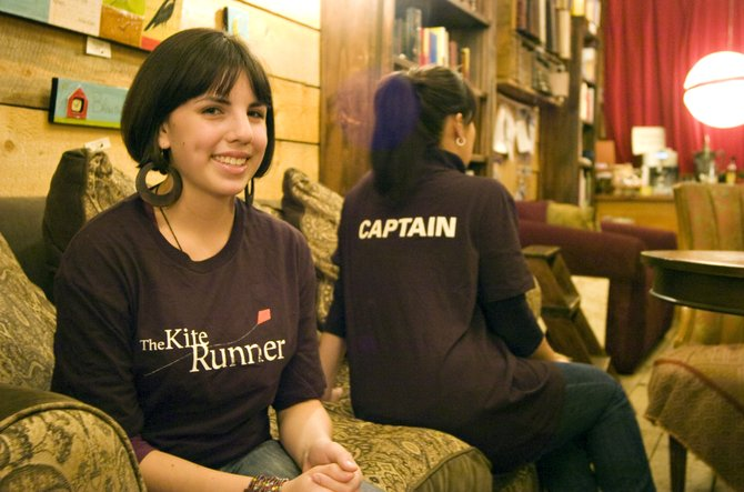 Marilyn Harris, left, and Kimberly Saari show off The Kite Runner promotional t-shirts at Epilogue Book Co. in Steamboat Springs on Wednesday afternoon.