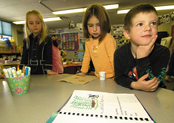 "Kindergartners Caleb Sharp and Lilian Stevens talk about a class project titled ""Dear World,"" a book that explains the children's views about our world and the environmental challenges their generation may be facing in the future."