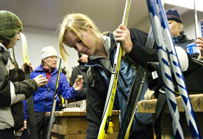 Steamboat Springs High School ninth-grader Liza Stout, center, waxes her skis before the high school's cross-country ski team practice at Howelsen Hill in Steamboat Springs on Thursday afternoon.