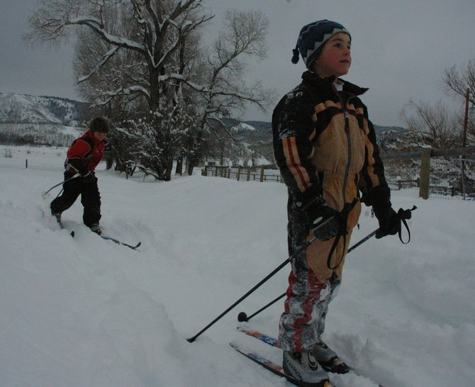 Luke Jankoski, left, and Tyler Anderson warm up Thursday before cross-country ski practice near the North Routt Community Charter School.