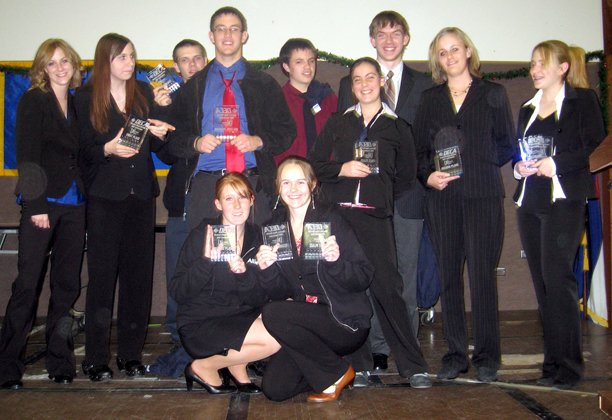 Some of the members who competed at the DECA Districts in Grand Junction on Dec. 8 and 9, include, in back from left, Heather Sperry, Becky Meek, John Ungefug, Austin Hill, Nick Marchbanks, Cassie Gore, Tyler Kalsow, Emily Willems, Jessica Hogue; and in front, Allie Liljedahl and Desiree Holland. Missing from photo is Katryna Snowden.