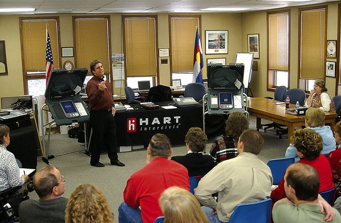 A Hart Intercivic representative displays his company's electronic voting equipment to Routt County officials and residents in this file photo. On Monday, Colorado Secretary of State Mike Coffman decertified some of Hart's voting equipment, including the paper ballot counter used by Routt County.