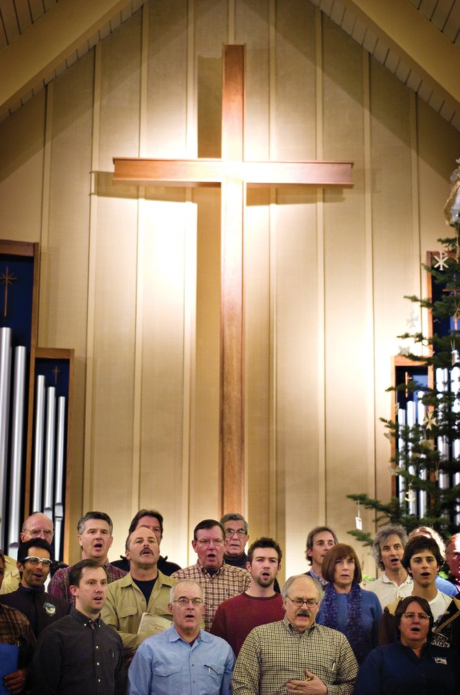 """Choir members rehearse for the upcoming production of Handel's """"Messiah"""" in the sanctuary at the Steamboat Springs United Methodist Church on Tuesday night."""