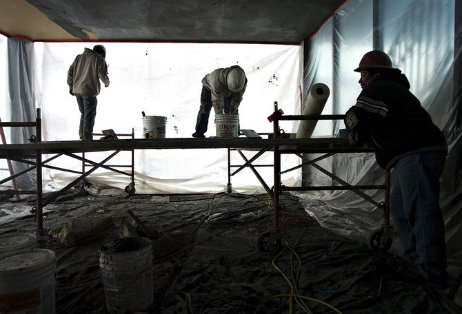 Contracted employees work to complete construction on the exterior of the Old Town Hot Springs improvement project Wednesday afternoon in Steamboat Springs.