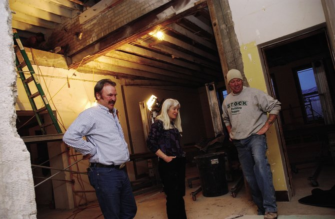 Routt County Commissioners Doug Monger, left, and Diane Mitsch Bush discuss the Routt County Courthouse renovation project with job site superintendent Rob Davis, who works for Holmquist-Lorenz Construction Company.