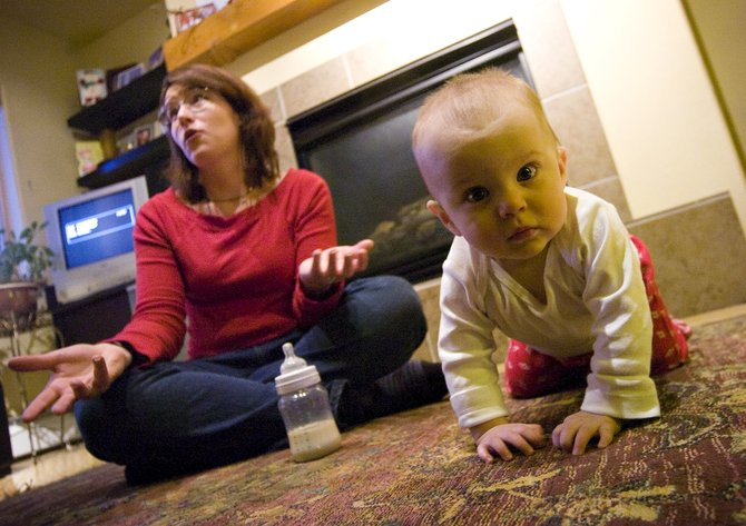 Eight-month-old Jacqueline DeCrette checks out the camera as her mother, Nicole, chats with a reporter about the difficulties of finding child care for kids born to employees of the Steamboat Springs School District.
