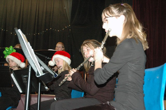 Seventh-graders Katie Donovan, from left, and Jaelyn Wahley, and eighth-graders Brittany Shaffer and Kayla Harves, perform with the Soroco Middle School Concert Band during the Soroco Music Department's Holiday Concert on Tuesday night.