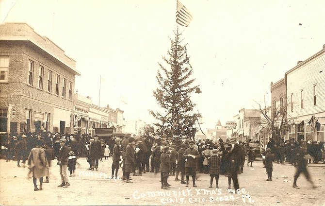 Moffat County residents gather around a Christmas tree set up on the corner of Yampa Avenue and Victory Way during a community Christmas celebration Dec. 24, 1917. At the time, community holiday celebrations were more popular than smaller, church-based events.