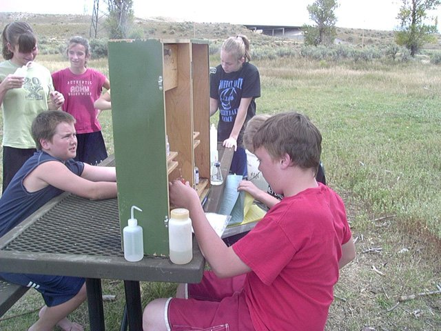 Students enrolled in Craig Middle School's RiverWatch class test river water samples last fall. The tests reveal the river's health and teach students about human impact on water systems.