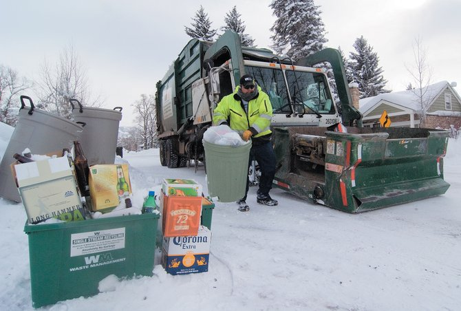 Ivan Aguilar was busy Wednesday afternoon hauling trash from in front of houses in downtown Steamboat Springs. He said the amount of trash left at the curb was a little higher than normal - the result of the Christmas holiday.