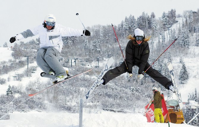 David Lamb, left, and Brett Buckles launch off a jump prior to the Rail Rodeo at the Steamboat Ski Area last week. The former Alpine racers have found new life as skiercross competitors. Both are hoping to find their way to the Winter Olympic Games in 2010 in Vancouver, Canada.