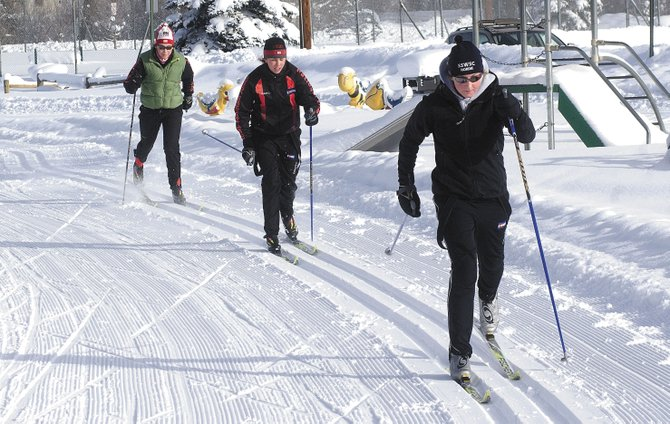 Melissa Krause, right, Mary Rose and Molly Newman train for the 2008 U.S. Cross Country Championships earlier this week in Steamboat. The three skiers will be part of a group headed to Houghton, Mich., this week.