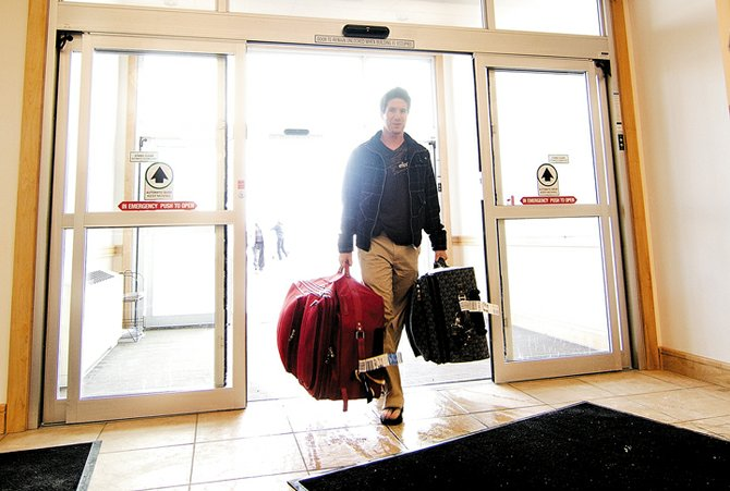 Jack Tomberlin, of California, arrives at the Yampa Valley Regional Airport for his trip back home. After a somewhat chaotic day Sunday, things seemed to be back on track at the airport Monday.