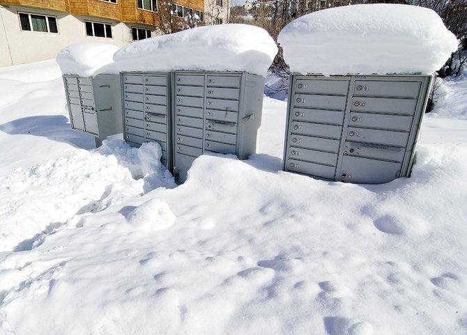 Skiers in the Steamboat Springs area have welcomed recent snowstorms, but the heavy snow hasn't been as easy on those delivering mail. The post office wants to remind the public to keep the area around cluster boxes clear, so that the large doors can be opened easily to deliver the mail.