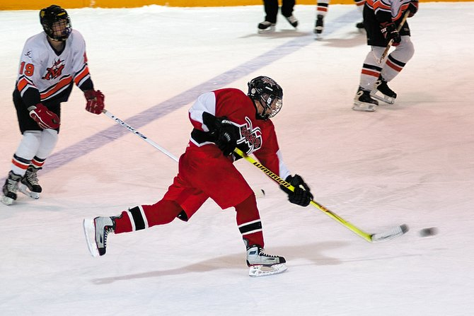 Steamboat Springs senior Alex Palaniuk unleashes a slap shot in the first period of Friday night's game against Mitchell at the Howelsen Ice Arena. Steamboat took a 2-0 lead after the first period.