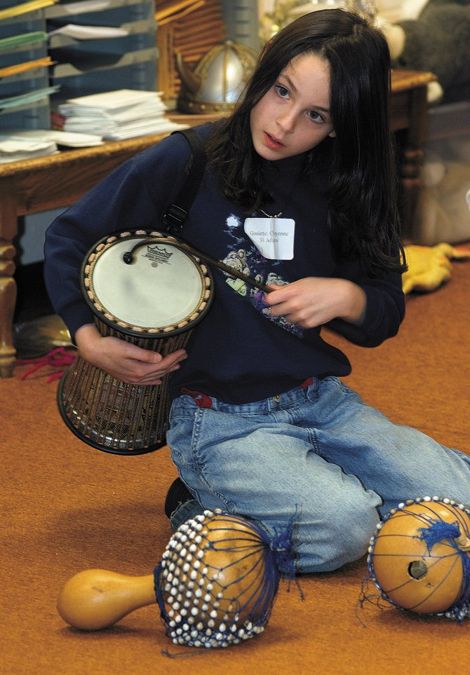 Cheyenne Goulette plays the drums at Strawberry Park Elementary School on Friday afternoon as part of the school's all day arts festival. The students had an opportunity to learn about the arts first hand through a number of different lectures and workshops.