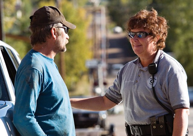 With many part-time and seasonal police officers, such as Eileen Rossi, right, the small Oak Creek Police Department is seeking volunteers through a federal program to help fill the void.