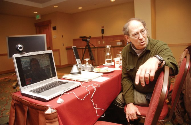 "Stephen Schneider, a professor of Biological Sciences at Stanford University, speaks with New York Times Science Editor Andrew Revkin during a Web video conference Wednesday at the 19th Annual Steamboat Weather Summit held at the Steamboat Grand Resort Hotel. Revkin was the speaker for a session titled ""How the Media Covers the Climate Change Issue."""