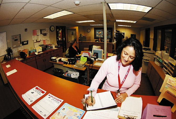 Kandise Gilbertson, a learning support specialist, fills out paperwork at Steamboat Springs Middle School on Wednesday afternoon. The middle school is hoping the Steamboat Springs Education Fund Board will provide money needed to move the offices to the front of the school, improving security and safety concerns.