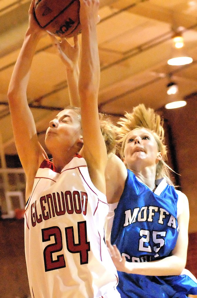 Moffat County High School senior Amy Dilldine looks to take the rebound from Glenwood Springs High School junior Katrina Selsor in Friday's game in Glenwood Springs. Glenwood won the home contest.