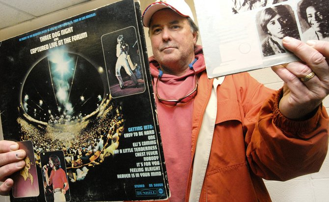 Dave Pike, city of Craig Parks and Recreation director, holds two Three Dog Night albums from his personal collection.  Three Dog Night is scheduled to play at Craig's Centennial concert July 12.