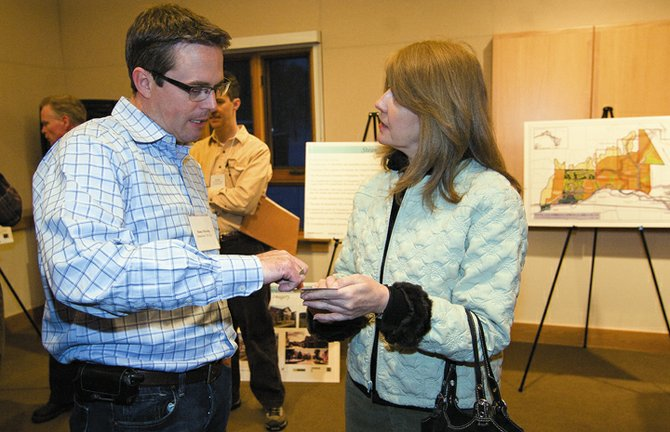 Steamboat 700 Project Manager Danny Mulcahy talks with Steamboat resident Lynne Grimsley during an open house at Centennial Hall on Tuesday evening. The open house was designed to invite the public to see the proposed plans for the development west of Steamboat Springs and to address any concerns.