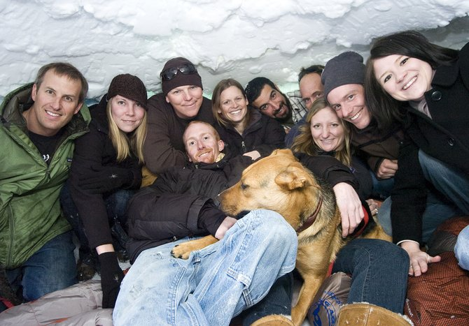 The Big Agnes, Honey Stinger and BAP! teams gather for a photo in an igloo outside the BAP! retail shop in Steamboat Springs on Wednesday afternoon. Products created by the three sister companies have won awards, which are displayed at BAP's Oak Street store.
