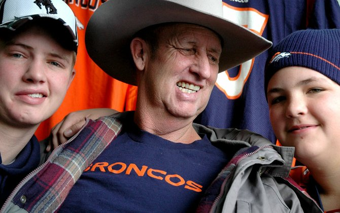 Don Pankey, center, gazes at his son Michael, right, with his other son Christopher on his left. The trio are Bronco fans and went to the Denver Broncos' last regular season game - a gift from the Tony Maneotis family and Bronco center Tom Nalen.