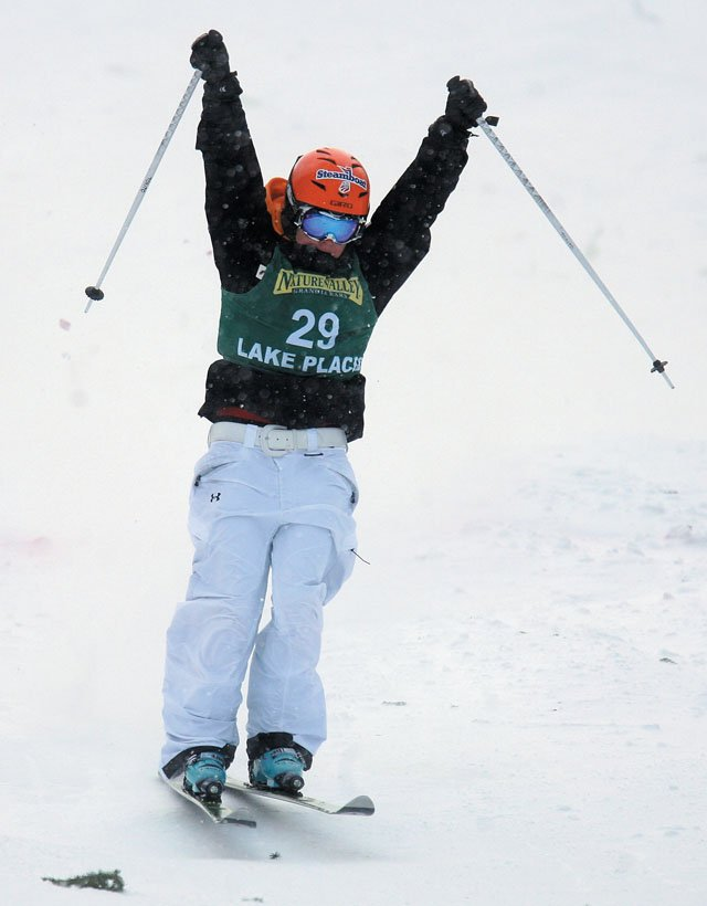 Emiko Torito raises her arms after her run in the 2008 Freestyle FIS World Cup Women's Moguls on Friday at Whiteface Mountain in Lake Placid, N.Y.  Torito won the event.