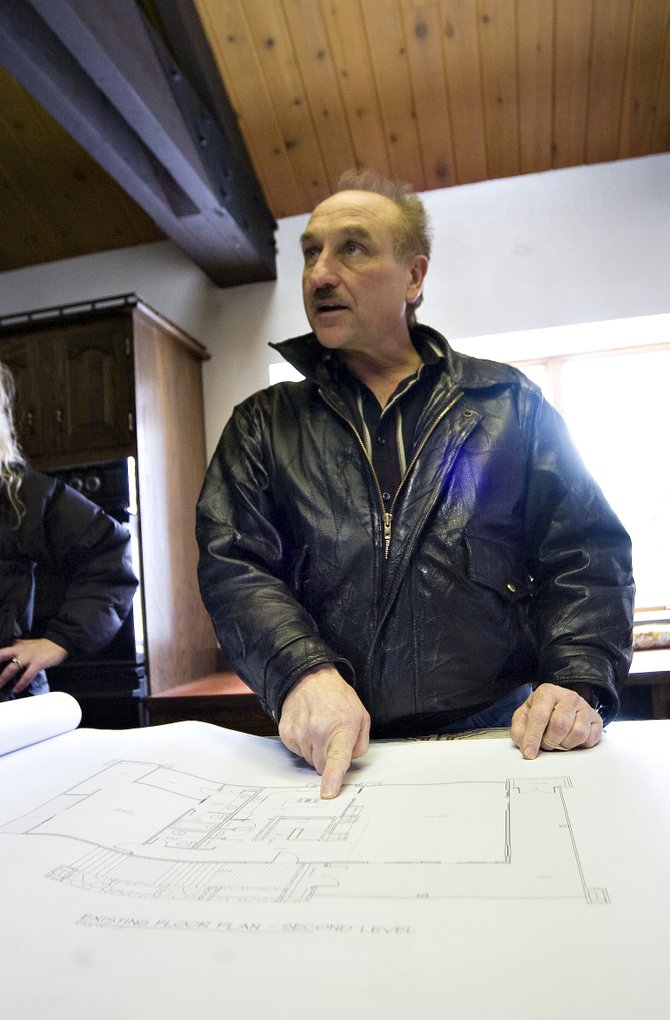Local architect Ed Becker shows off a series of plans for a house to be used by the Northwest Colorado Visiting Nurse Association's hospice services in Steamboat Springs on Friday afternoon.