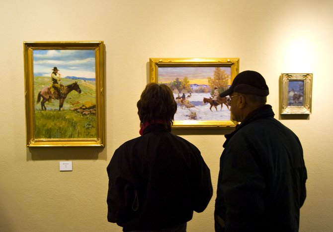 Paula Salter, left, and Sammy Salter peruse a display of paintings at the Steamboat Art Museum in downtown Steamboat Springs on Friday afternoon. The art museum's board of directors would like the museum to occupy all of the Rehder Building, which also houses Antares restaurant and Vectra Bank.