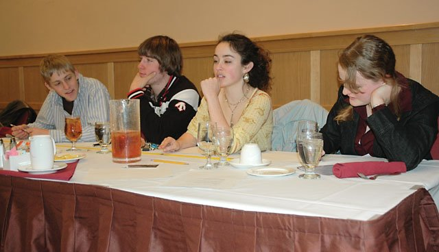 Steamboat Springs High School Knowledge Bowl team members compete Tuesday in a mock knowledge bowl contest against Steamboat Rotary Club members. From left, Charlie Stoddard, Sam Chovan, Miriam Pensack and Anna Roder beat the Rotarians, 20-5, in the 40-question quiz.