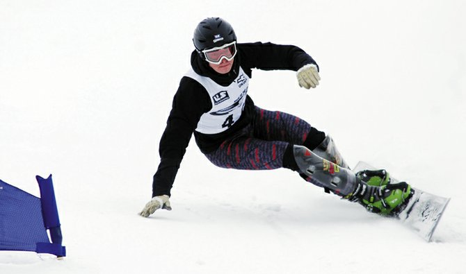 Steamboat Springs' snowboarder Justin Reiter clears a gate during a Race to the Cup event held in Steamboat Springs earlier this month. Reiter finished eighth in a parallel slalom race in Spain last weekend.