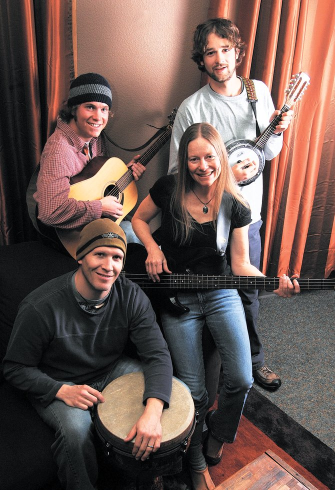 Ryan Cox, clockwise from back left, Andrew Henry, Carol Ives and Pat Waters of Missed the Boat, a local band with a bluegrass touch that is looking for chances to play.