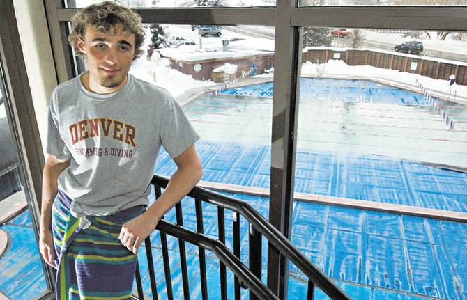 Steamboat Springs' swimmer Cole Worsley stands in the tower overlooking the Old Town Hot Springs before a work out Thursday afternoon. Worsley, who finished second in the 50-yard freestyle event at last year's state championships, has been working hard in the off season to improve his times.