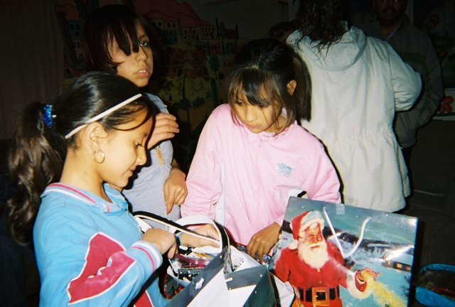 Young girls in an orphanage in Agua Prieto, Mexico, open holiday presents from the Steamboat Springs community. Local Rotarians gathered gifts for about 90 children at two orphanages in the city, just south of the Arizona border.