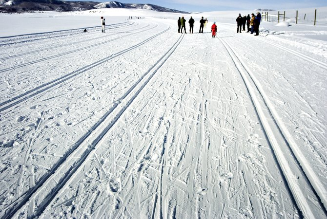 Judges and spectators wait for contestants to finish a classic cross-country skiing race at the Lake Catamount Touring Center outside of Steamboat Springs on Saturday morning.