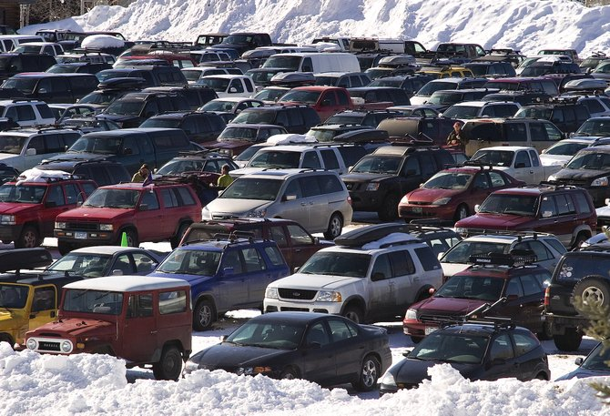 Row upon row of parked cars fill the Meadows lot Saturday, another busy day at Steamboat Ski Area. Local ski officials are working on plans to handle crowds this year and into the future.