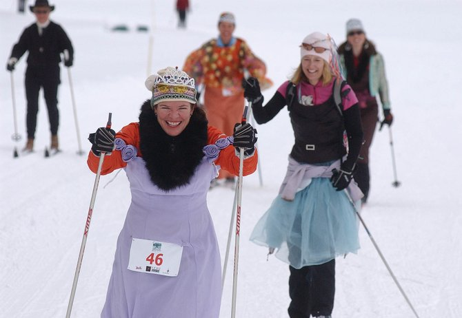 Steamboat Springs resident Sheila Wright leads a pack of skiers Sunday during Colorado Ski for Women day at the Steamboat Ski Touring Center. More than 100 people participated in the event, which benefited Advocates Against Battering and Abuse.
