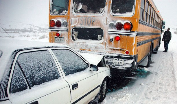 Pat Duzik, a mechanic with the Moffat County School District, inspects bus No. 68 after it was rear-ended Wednesday morning. No one was injured in the crash.