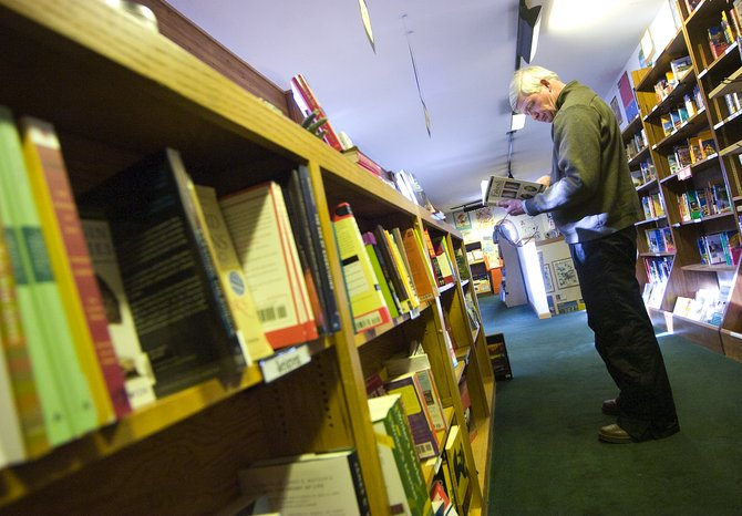 Ed Johns checks out the book selection at Off the Beaten Path Bookstore in Steamboat Springs on Thursday afternoon.  The bookstore will be moving to a new location on Ninth Street in March.