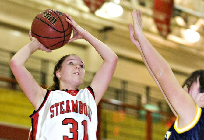 Steamboat's Gracie Stockdale, left, shoots a jumper over a Rifle defender during the Sailors' game against the Bears in Steamboat Springs on Friday night. The Sailors lost to the Bears, 54-21.