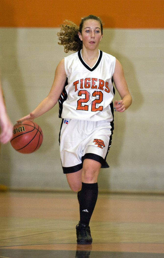 Hayden's Caitlin Mahanna dribbles the ball down the court during the Tigers' game against the Plateau Valley Cowboy Girls in Hayden on Saturday night.  The Cowboy Girls defeated the Tigers, 59-49.