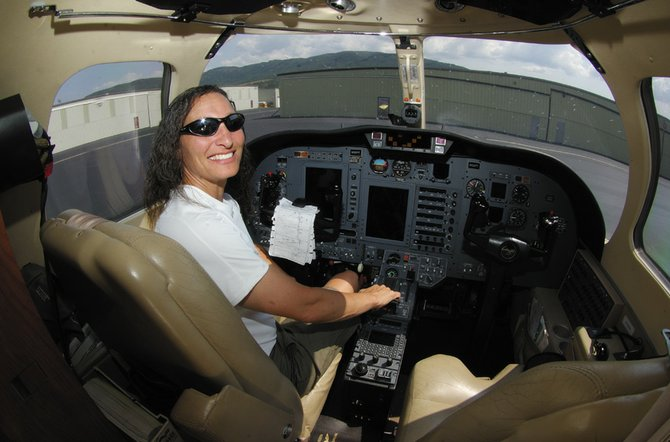 Jeanette Symons sits in cockpit  of her Cessana Citation C-525 last summer at the Steamboat Springs airport. Symons normally used the plane to commute between Steamboat Springs residence and another home in San Francisco.