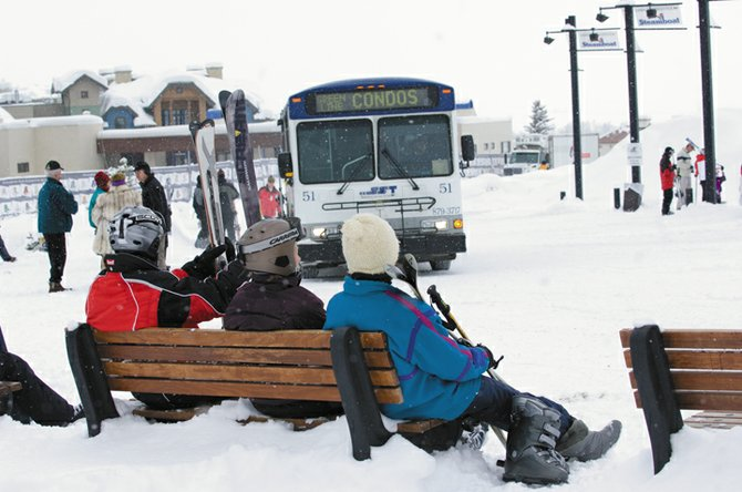 After a day of powder on Mount Werner Monday, passengers wait for a bus at the transit center at the Steamboat Ski Area. Steamboat Springs Transit followed a record-setting 2007 with all-time high ridership numbers in January.